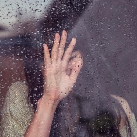 woman against window