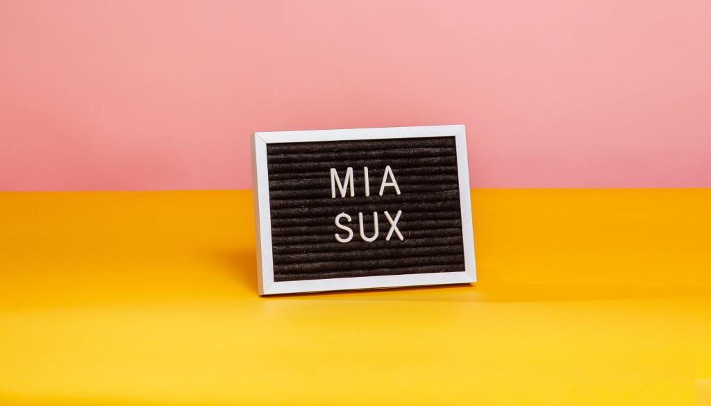 mia sux letter board sign